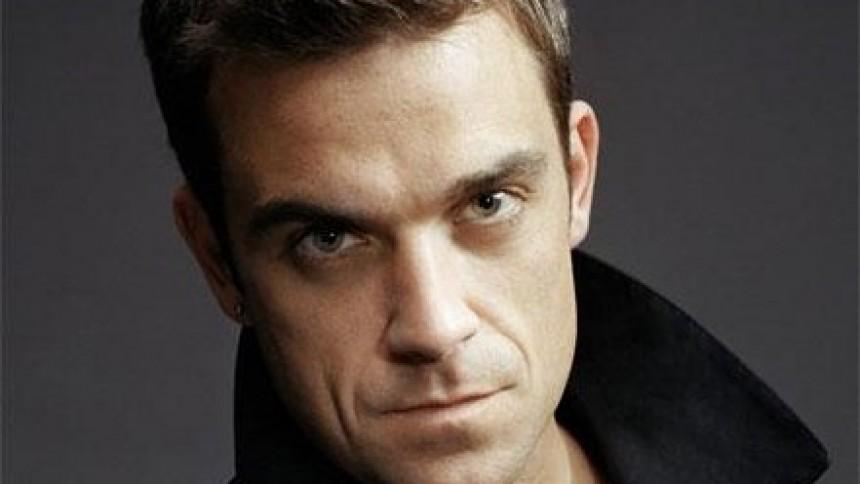 Robbie Williams giver til velgørenhed